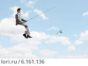 Купить «Businessman with rod», фото № 6161136, снято 22 марта 2010 г. (c) Sergey Nivens / Фотобанк Лори