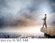 Купить «Businessman with rod», фото № 6161144, снято 2 июля 2020 г. (c) Sergey Nivens / Фотобанк Лори
