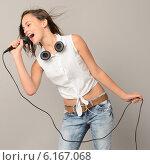 Купить «Singing teenage girl with microphone karaoke music», фото № 6167068, снято 1 июля 2014 г. (c) CandyBox Images / Фотобанк Лори