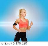 Купить «sporty woman running with smartphone and earphones», фото № 6170320, снято 8 мая 2014 г. (c) Syda Productions / Фотобанк Лори