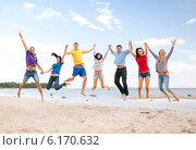 Купить «group of friends jumping on the beach», фото № 6170632, снято 31 августа 2013 г. (c) Syda Productions / Фотобанк Лори