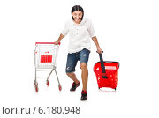 Купить «Man shopping with supermarket basket cart isolated on white», фото № 6180948, снято 2 июня 2014 г. (c) Elnur / Фотобанк Лори