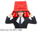 Купить «Man shopping with supermarket basket cart isolated on white», фото № 6181148, снято 6 июня 2014 г. (c) Elnur / Фотобанк Лори