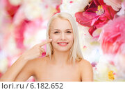 Купить «smiling young woman pointing at her cheek», фото № 6182652, снято 15 апреля 2014 г. (c) Syda Productions / Фотобанк Лори