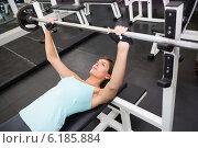 Купить «Fit brunette lifting heavy barbell lying on bench», фото № 6185884, снято 10 апреля 2014 г. (c) Wavebreak Media / Фотобанк Лори