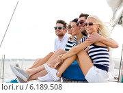 Купить «smiling friends sitting on yacht deck», фото № 6189508, снято 13 июля 2014 г. (c) Syda Productions / Фотобанк Лори