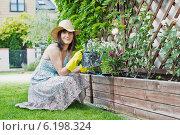 Купить «Woman in the garden.», фото № 6198324, снято 14 декабря 2019 г. (c) BE&W Photo / Фотобанк Лори