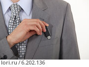 Купить «businessman putting a flash drive in his pocket», фото № 6202136, снято 4 апреля 2011 г. (c) Phovoir Images / Фотобанк Лори