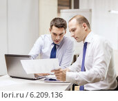 Купить «two businessmen having discussion in office», фото № 6209136, снято 9 ноября 2013 г. (c) Syda Productions / Фотобанк Лори