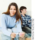 Купить «Sad woman with pregnancy test against boyfriend», фото № 6212732, снято 28 марта 2014 г. (c) Яков Филимонов / Фотобанк Лори