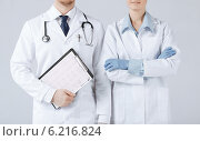Купить «nurse and male doctor holding cardiogram», фото № 6216824, снято 10 апреля 2013 г. (c) Syda Productions / Фотобанк Лори