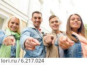 Купить «group of smiling friends in city pointing finger», фото № 6217024, снято 14 июня 2014 г. (c) Syda Productions / Фотобанк Лори