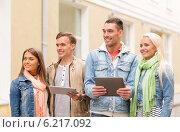 Купить «group of smiling friends with tablet pc computers», фото № 6217092, снято 14 июня 2014 г. (c) Syda Productions / Фотобанк Лори