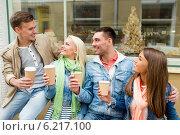 Купить «group of smiling friends with take away coffee», фото № 6217100, снято 14 июня 2014 г. (c) Syda Productions / Фотобанк Лори