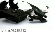 Купить «Broken video tape falling on white background», видеоролик № 6218112, снято 17 января 2019 г. (c) Wavebreak Media / Фотобанк Лори