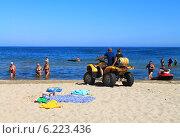 Купить «Активный отдых - квадроцикл на пляже. Куликово, Калининградская область», фото № 6223436, снято 19 июля 2014 г. (c) Михаил Рудницкий / Фотобанк Лори