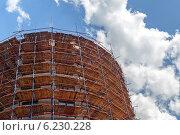 Купить «Строительные конструкции на фоне облачного неба», фото № 6230228, снято 9 июля 2014 г. (c) Родион Власов / Фотобанк Лори