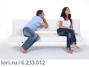 Купить «Man apolgising to woman on couch», фото № 6233012, снято 26 августа 2010 г. (c) Phovoir Images / Фотобанк Лори