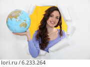 Купить «Woman holding globe», фото № 6233264, снято 20 декабря 2010 г. (c) Phovoir Images / Фотобанк Лори