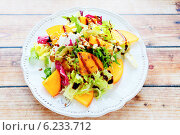 Купить «Диетический салат с хурмой на деревянном столе», фото № 6233712, снято 24 февраля 2014 г. (c) Афанасьева Ольга / Фотобанк Лори