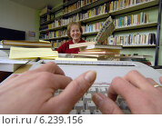Bad Schmiedeberg, Germany, civil workers of the school library when cataloging and detecting (2007 год). Редакционное фото, агентство Caro Photoagency / Фотобанк Лори