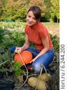 Купить «Young woman with pumpkin.», фото № 6244200, снято 24 августа 2019 г. (c) BE&W Photo / Фотобанк Лори