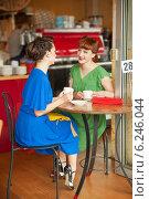 Купить «Две девушки за столиком в кафе», фото № 6246044, снято 5 июня 2013 г. (c) Кропотов Лев / Фотобанк Лори