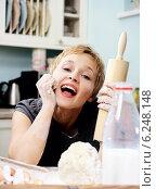 Купить «Young woman in the kitchen», фото № 6248148, снято 22 октября 2018 г. (c) BE&W Photo / Фотобанк Лори