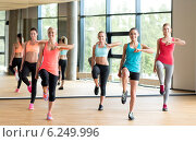 Купить «group of women working out in gym», фото № 6249996, снято 7 июня 2014 г. (c) Syda Productions / Фотобанк Лори