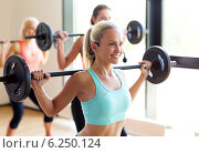 Купить «group of women with barbells in gym», фото № 6250124, снято 7 июня 2014 г. (c) Syda Productions / Фотобанк Лори