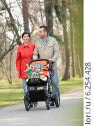 Купить «Family on the walk in the park», фото № 6254428, снято 21 января 2020 г. (c) BE&W Photo / Фотобанк Лори