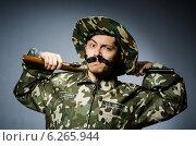 Купить «Funny soldier against the dark background», фото № 6265944, снято 26 апреля 2014 г. (c) Elnur / Фотобанк Лори
