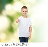 Купить «smiling boy in white t-shirt showing thumbs up», фото № 6276948, снято 3 июня 2014 г. (c) Syda Productions / Фотобанк Лори