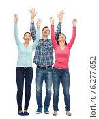 Купить «group of smiling teenagers with raised hands», фото № 6277052, снято 22 июня 2014 г. (c) Syda Productions / Фотобанк Лори