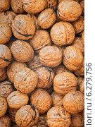 Фон из неочищенных грецких орехов. Стоковое фото, фотограф Maselko Vitaliy / Фотобанк Лори