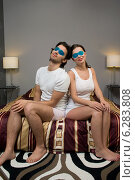 Купить «Woman and man sitting on bed with eye compresses.», фото № 6283808, снято 19 марта 2019 г. (c) BE&W Photo / Фотобанк Лори