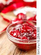 Купить «Bowl of cherry jam on wooden table and fresh cherries around», фото № 6284900, снято 23 июля 2019 г. (c) BE&W Photo / Фотобанк Лори