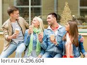 Купить «group of smiling friends with take away coffee», фото № 6296604, снято 14 июня 2014 г. (c) Syda Productions / Фотобанк Лори