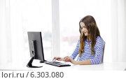Купить «Smiling teenage girl with computer at home», видеоролик № 6303080, снято 11 марта 2014 г. (c) Syda Productions / Фотобанк Лори