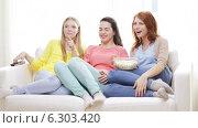 Купить «Three smiling teenage girls watching tv at home», видеоролик № 6303420, снято 8 мая 2014 г. (c) Syda Productions / Фотобанк Лори