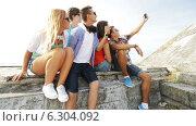 Купить «Group of smiling teenagers making selfie outdoors», видеоролик № 6304092, снято 12 августа 2014 г. (c) Syda Productions / Фотобанк Лори