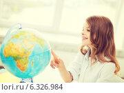 Купить «smiling student girl with globe at school», фото № 6326984, снято 31 июля 2013 г. (c) Syda Productions / Фотобанк Лори