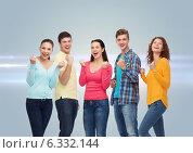 Купить «group of smiling teenagers showing triumph gesture», фото № 6332144, снято 22 июня 2014 г. (c) Syda Productions / Фотобанк Лори