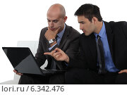 Купить «Two businessmen exchanging thoughts», фото № 6342476, снято 20 мая 2011 г. (c) Phovoir Images / Фотобанк Лори