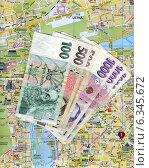 Купить «Концепт – путешествие в Прагу (Чехия). Чешские деньги (кроны) на карте Праги», эксклюзивное фото № 6345672, снято 22 ноября 2019 г. (c) Иван Марчук / Фотобанк Лори