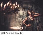 Купить «Tattooed beautiful woman in old spooky interior», фото № 6346740, снято 19 июля 2014 г. (c) Andrejs Pidjass / Фотобанк Лори