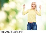 Купить «laughing young woman with hands up», фото № 6350844, снято 15 апреля 2014 г. (c) Syda Productions / Фотобанк Лори