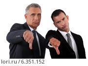 businessmen, thumbs down. Стоковое фото, фотограф Phovoir Images / Фотобанк Лори