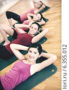 Купить «group of smiling women exercising in the gym», фото № 6355012, снято 28 сентября 2013 г. (c) Syda Productions / Фотобанк Лори