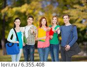 Купить «group of smiling students standing», фото № 6355408, снято 4 мая 2014 г. (c) Syda Productions / Фотобанк Лори